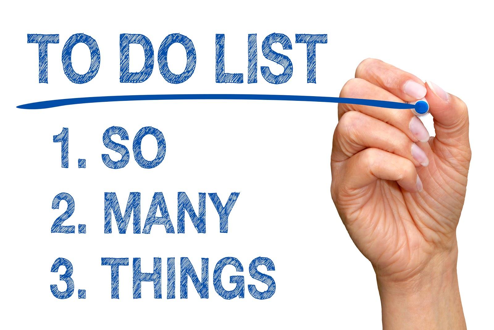 A hand writes a 3 task to do list